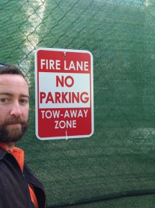 Here's a picture of me with a no parking sign.