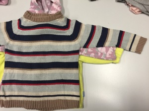 Notice the vastly different arm lengths for these same size sweaters.